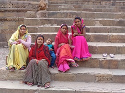 India Khajuraho ladies on stairs